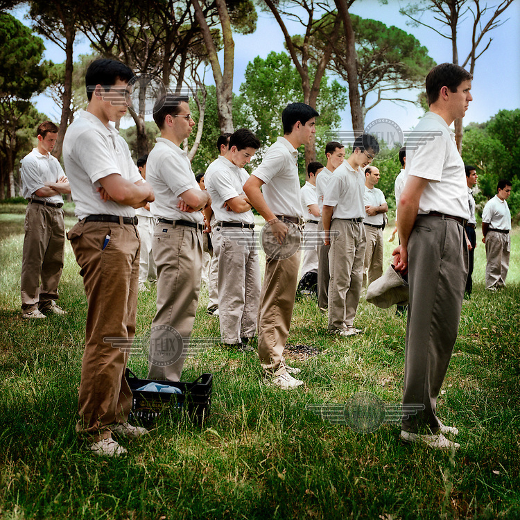 Legionaries of Christ priests prepare for exercise in a suburb of Rome. Once a month they go out of their community to exercise. The Legion of Christ is a conservative Roman Catholic congregation whose members take vows of chastity, obedience and poverty.