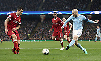 Manchester City's David Silva slides a pass despite the attentions of Liverpool's Dejan Lovren<br /> <br /> Photographer Rich Linley/CameraSport<br /> <br /> UEFA Champions League Quarter-Final Second Leg - Manchester City v Liverpool - Tuesday 10th April 2018 - The Etihad - Manchester<br />  <br /> World Copyright &copy; 2017 CameraSport. All rights reserved. 43 Linden Ave. Countesthorpe. Leicester. England. LE8 5PG - Tel: +44 (0) 116 277 4147 - admin@camerasport.com - www.camerasport.com