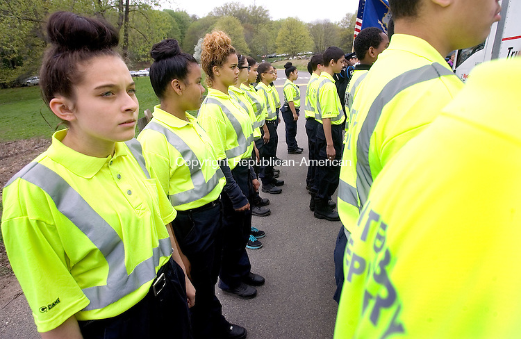 MIDDLEBURY CT. 09 May 2015-050915SV03-Carly Esposito, 13, of Waterbury, left, lines up with fellow explorers during the opening ceremony of the Xplorathon 2015 5k run/jog or walk at Hop Brook State Park in Middlebury Saturday.  The race was 3.1 mile long with obstacles that were mixed in throughout the trail. Proceeds of the event will benefit the children of the Waterbury Police Explorers. <br /> Steven Valenti Republican-American