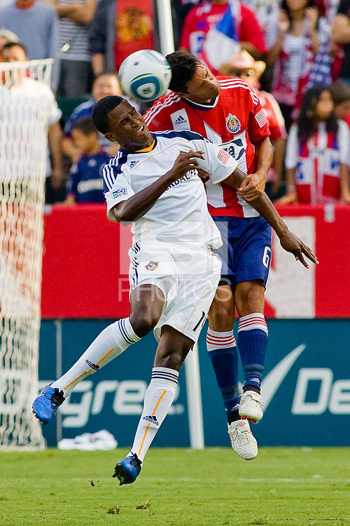LA Galaxy forward Edson Buddle and Ante Jazic defender for Chivas USA battle head to head. The LA Galaxy beat Chivas USA 2-1 at Home Depot Center stadium in Carson, California on Sunday October 3, 2010.