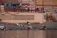 Men washing clothes in Ganges river, Dhobi Ghat, Varanasi, India