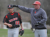 Newfield pitcher No. 22 Brandon Alberto, right, gets a pack on the back from head coach Paul Pedersen after throwing a complete game and striking out 11 batters in a 10-5 win against host Half Hollow Hills West High School in Suffolk County League IV varsity baseball game on Wednesday, April 8, 2015.<br /> <br /> James Escher