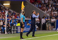 LYON,  - JULY 2: Phil Neville yells to his team during a game between England and USWNT at Stade de Lyon on July 2, 2019 in Lyon, France.