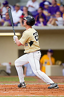 Charlie Morgan #26 of the Wake Forest Demon Deacons follows through on his swing against the LSU Tigers at Alex Box Stadium on February 20, 2011 in Baton Rouge, Louisiana.  The Tigers defeated the Demon Deacons 9-1.  Photo by Brian Westerholt / Four Seam Images