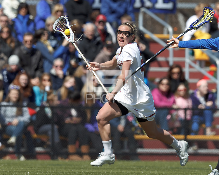 Boston College midfielder Kate McCarthy (20) on the attack. Boston College (white) defeated Duke University (blue), 10-9, on the Newton Campus Lacrosse Field at Boston College, on April 6, 2013.