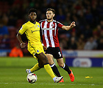 Jack O'Connell of Sheffield Utd tussles with Ellis Harrison of Bristol Rovers during the League One match at Bramall Lane Stadium, Sheffield. Picture date: September 27th, 2016. Pic Simon Bellis/Sportimage