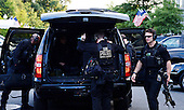 Members of the United States Secret Service that travel with U.S. President Barack Obama arrive at the White House October 1, 2014 in Washington, DC. Julia Pierson, the director of the U.S. Secret Service, resigned Wednesday amid embarrassing new revelations of breaches to the protective cordon around President Obama. <br /> Credit: Olivier Douliery / Pool via CNP