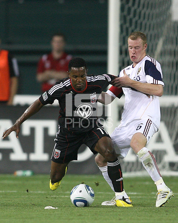 Luciano Emilio #11 of D.C. United is held up by Nat Borchers #6  of Real Salt Lake during an Open Cup match at RFK Stadium, on June 2 2010 in Washington DC. DC United won 2-1.