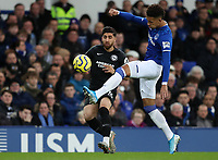 11th January 2020; Goodison Park, Liverpool, Merseyside, England; English Premier League Football, Everton versus Brighton and Hove Albion; Mason Holgate of Everton tackles Alireza Jahanbakhsh of Brighton and Hove Albion - Strictly Editorial Use Only. No use with unauthorized audio, video, data, fixture lists, club/league logos or 'live' services. Online in-match use limited to 120 images, no video emulation. No use in betting, games or single club/league/player publications