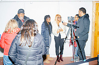 A reporter interviews women from Delaware State University after Democratic presidential candidate and former Vice President Joe Biden spoke a campaign event at The Sports Barn in Hampton, New Hampshire, on Sun., December 8, 2019.