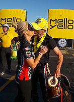 Nov 13, 2016; Pomona, CA, USA; NHRA pro stock motorcycle rider Matt Smith (right) celebrates with wife Angie Smith after winning the Auto Club Finals at Auto Club Raceway at Pomona. Mandatory Credit: Mark J. Rebilas-USA TODAY Sports