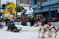 Linwood Fiedler and team leave the ceremonial start line with an Iditarider and handler at 4th Avenue and D street in downtown Anchorage, Alaska on Saturday March 3rd during the 2018 Iditarod race. Photo ©2018 by Brendan Smith/SchultzPhoto.com