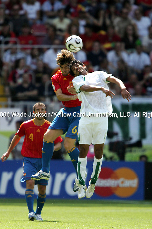 23 June 2006: David Albelda (ESP) (6) and Saad Al Harthi (KSA) (11) challenge for a header. Spain defeated Saudi Arabia 1-0 at Fritz-Walter Stadion in Kaiserslautern, Germany in match 47, a Group H first round game, of the 2006 FIFA World Cup. With the win, Spain goes through as the top team in Group H, while Saudi Arabia is eliminated with the loss.