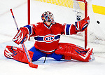 10 February 2010: Montreal Canadiens' goaltender Carey Price makes a third period save against the Washington Capitals at the Bell Centre in Montreal, Quebec, Canada. The Canadiens defeated the Capitals 6-5 in sudden death overtime, ending Washington's team-record winning streak at 14 games. Mandatory Credit: Ed Wolfstein Photo