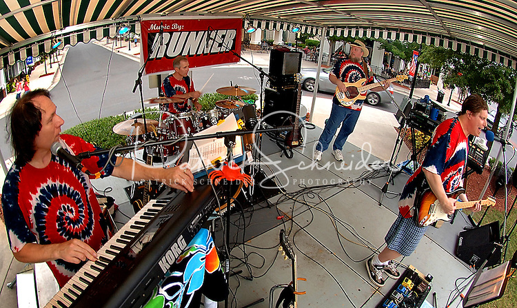The band Runner plays during the annual Fourth of July Celebration and community parade in Birkdale Village in Huntersville, NC. Birkdale Village combines the best of shopping, dining, apartments and entertainment venues within a 52-acre mixed-use development.