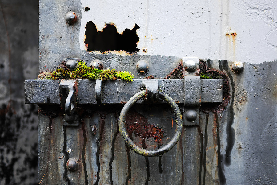 Rusty grey steel door in concrete bunker, Artillery Hill, Fort Worden State Park, Port Townsend, Washington, USA
