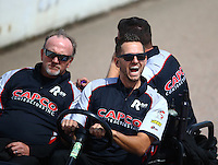 May 22, 2016; Topeka, KS, USA; Crew members for NHRA top fuel driver Steve Torrence during the Kansas Nationals at Heartland Park Topeka. Mandatory Credit: Mark J. Rebilas-USA TODAY Sports