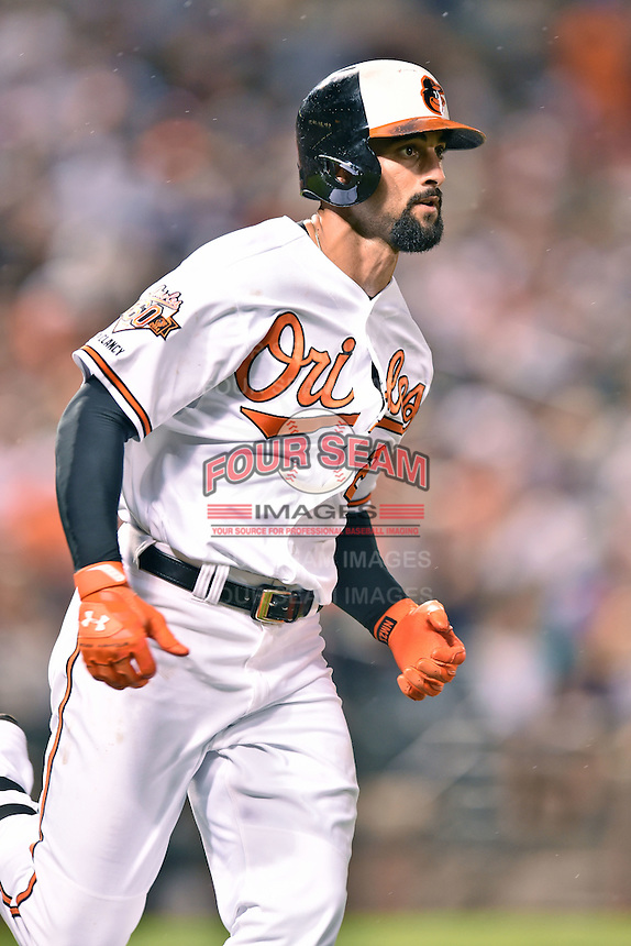 Baltimore Orioles right fielder Nick Markakis #21 runs to first during a game against the New York Yankees at Oriole Park at Camden Yards August 11, 2014 in Baltimore, Maryland. The Orioles defeated the Yankees 11-3. (Tony Farlow/Four Seam Images)