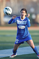 Boston Breakers midfielder Jo Dragotta (25) lines up a head ball. In a National Women's Soccer League Elite (NWSL) match, the Boston Breakers (blue) tied the Washington Spirit (white), 1-1, at Dilboy Stadium on April 14, 2012.
