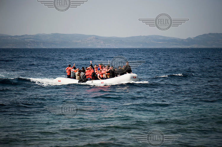 A group of Syrian refugees on a small inflatable boat near the beach of Skala Sykaminias on the island of Lesbos. Every day hundreds of refugees, mainly from Syria and Afghanistan, are crossing in small overcrowded inflatable boats the six mile channel from the Turkish coast to the island of Lesbos in Greece. Many spend their life savings, over $1,000, to buy a space on these boats.