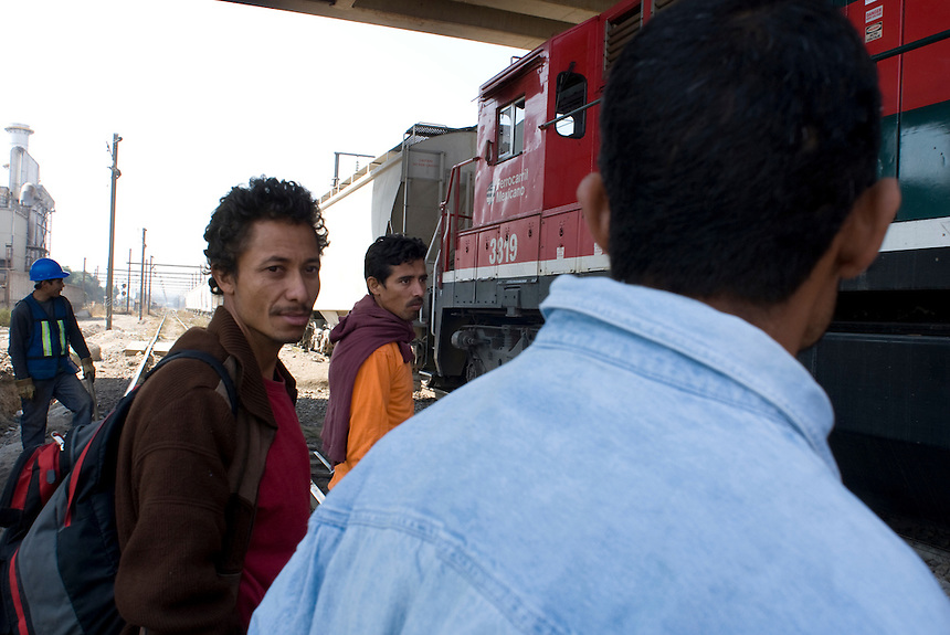 "Three Honduran immigrants on their way to the US catch the train known as ""El Tren de La Muerte"" (the train of death) because so many immigrants have been killed riding it or by falling off or murdered by gangs. Lecheria, Estado de Mexico, Mexico. Wednesday, Feb. 13, 2008"