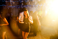 A young Anglo Indian girl dances in a new year's party in Kolkata.