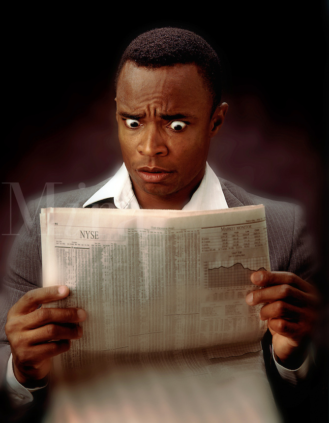 African American businessman reading the newspaper stock pages. stock market, investing, expressions, alarm, shock, surprise, distress, black, man, men, male.