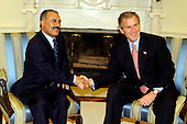 United States President George W. Bush shakes hands with President Ali Abdullah Saleh of Yemen during a photo-op in the Oval Office of the White House in Washington, D.C.  They were meeting to discuss U.S. - Yemeni relations on November 27, 2001..Credit: Ron Sachs / CNP