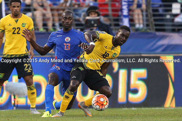 18 July 2015: Simon Dawkins (JAM) (18) and Kevin Lafrance (HAI) (13). The Jamaica Men's National Team played the Haiti Men's National Team at M&T Bank Stadium in Baltimore, Maryland in a 2015 CONCACAF Gold Cup quarterfinal match. Jamaica won the game 1-0.