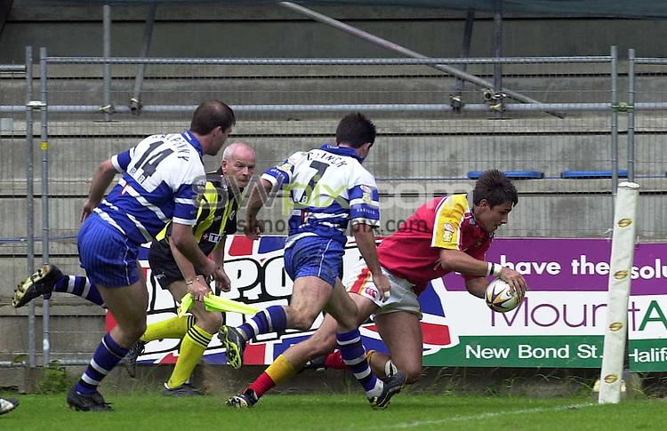 Pix: Ben Duffy/SWpix.com....Rugby Super League- Hallifax Town v London Broncos.....30/06/2002..COPYWRIGHT PICTURE>>SIMON WILKINSON>>01943 436649>>..Halifax's Gavin Clinch cannot stop London's Sylvain Houles from going over for a try