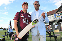 Dilip Jajodia of Dukes presents the man of the match award to Aaron West of Brentwood - Essex Cricket League Dukes T20 Finals Day at Billericay Cricket Club - 28/07/13 - MANDATORY CREDIT: Gavin Ellis/TGSPHOTO - Self billing applies where appropriate - 0845 094 6026 - contact@tgsphoto.co.uk - NO UNPAID USE