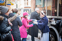 Actors in servants' costumes serve tea and biscuits to passer-by at Masterpiece's Downton Abbey truck in midtown in New York on Wednesday, December 11, 2013. Season Four of the popular PBS series begins on Sunday, January 5, 2014 in the United States.(© Richard B. Levine)