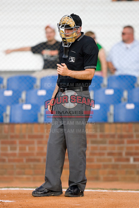 Home plate umpire Luke Engen checks the count on his clicker during an Appalachian League game between the Elizabethton Twins and the Johnson City Cardinals at Howard Johnson Field July 3, 2010, in Johnson City, Tennessee.  Photo by Brian Westerholt / Four Seam Images