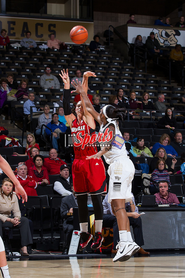 Sara Hammond (00) of the Louisville Cardinals shoots over Milan Quinn (32) of the Wake Forest Demon Deacons during second half action at the LJVM Coliseum on January 11, 2015 in Winston-Salem, North Carolina.  The Cardinals defeated the Demon Deacons 79-68.  (Brian Westerholt/Sports On Film)