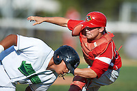 Batavia Muckdogs catcher Casey Rasmus #55 tags out Jesus Solorzano #12 during game one of a NY-Penn League doubleheader against the Jamestown Jammers at Russell Diethrick Park on September 5, 2012 in Jamestown, New York.  Jamestown defeated Batavia 1-0.  (Mike Janes/Four Seam Images)