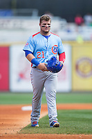 Dan Vogelbach (21) of the Tennessee Smokies walks towards the dgout at the end of the top of the first inning during the game against the Birmingham Barons at Regions Field on May 3, 2015 in Birmingham, Alabama.  The Smokies defeated the Barons 3-0.  (Brian Westerholt/Four Seam Images)