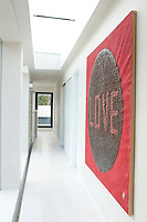 The 'Love' painting on the landing is from East Africa and made with Coke bottle tops
