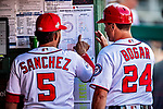 26 September 2018: Washington Nationals infielder Adrian Sanchez reviews the lineup card with First Base Coach Tim Bogar prior to a game against the Miami Marlins at Nationals Park in Washington, DC. The Nationals defeated the visiting Marlins 9-3, closing out Washington's 2018 home season. Mandatory Credit: Ed Wolfstein Photo *** RAW (NEF) Image File Available ***