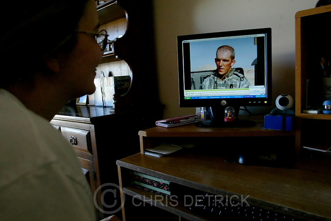 Enoch,Utah--9/16/2005--9:01:14 AM--.After checking her email Sandra Tripplett looks at pictures of Charles on her computer...Sandra Triplett is married to 1st Lt. Charles Triplett, a junior officer with the 222nd Field Artillery in Ramadi. They have been apart for 8 weeks and will not be together again until January....**********************************.Photo By: Chris Detrick /Salt Lake Tribune.File Number: 816G4576.