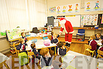 Santa visiting the Junior Infants in Mrs Deirdre O'Connors Class in the Boys National School in Listowel.