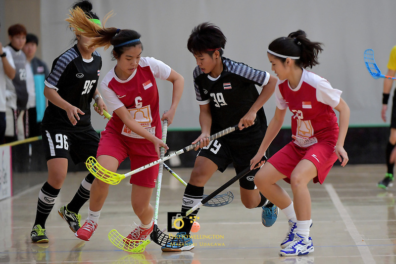 Thailand's Pichawee Yoola and Singapore's Mindy Lim in action during the World Floorball Championships 2017 Qualification for Asia Oceania Region - Singapore v Thailand at ASB Sports Centre , Wellington, New Zealand on Sunday 5 February 2017.<br /> Photo by Masanori Udagawa<br /> www.photowellington.photoshelter.com.