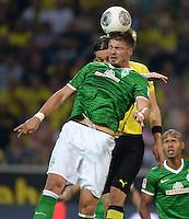FUSSBALL  1. BUNDESLIGA  SAISON 2013/2014   3. SPIELTAG Borussia Dortmund - Werder Bremen                  23.08.2013 Sebastian Proedl (SV Werder Bremen) vor Neven Subotic (Borussia Dortmund)