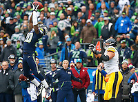 Jeremy Lane #20 of the Seattle Seahawks intercepts a pass in front of Jesse James #81 of the Pittsburgh Steelers during the game at CenturyLink Field on November 29, 2015 in Seattle, Washington. (Photo by Jared Wickerham/DKPittsburghSports)