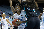 21 November 2013: North Carolina's Hillary Fuller (13) is defended by Coastal Carolina's Katelyn Connor (40). The University of North Carolina Tar Heels played the Coastal Carolina University Chanticleers in an NCAA Division I women's basketball game at Carmichael Arena in Chapel Hill, North Carolina. UNC won the game 106-52.