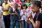 A young girl sings during a karaoke session at a summer festival organised by Walterton and Elgin Community Homes, a resident-controlled housing association in North Paddington, London.
