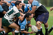 J. Takamore is put under pressure from J. Davies as he passes from a scrum. CMRFU Premier Club Rugby round 4 game between Manurewa & Weymouth played at Manurewa on the 5th of May 2007. Manurewa led 24 - 0 at halftime and went on to win 43 - 7.