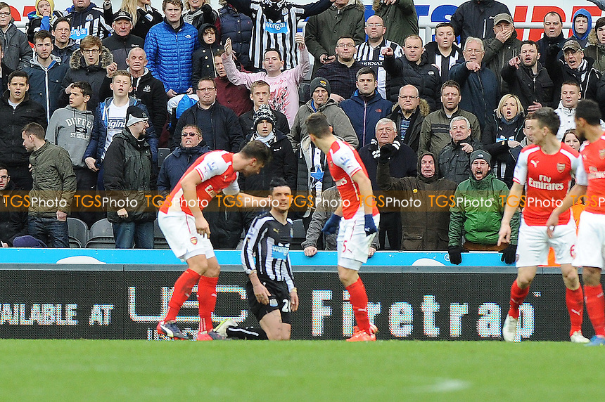 Arsenal defenders shout at Rémy Cabella of Newcastle United after he goes down to try and win a penalty - Newcastle United vs Arsenal - Barclays Premier League Football at St James Park, Newcastle upon Tyne - 21/03/15 - MANDATORY CREDIT: Steven White/TGSPHOTO - Self billing applies where appropriate - contact@tgsphoto.co.uk - NO UNPAID USE