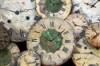 These clock faces with a weathered patina were found over the entrance of a watchmaker's shop in a coastal town in Brittany