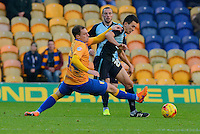 Mansfield Town's Adam Chapman challenges Wycombe Wanderers goalscorer Luke O'Nien during the Sky Bet League 2 match between Mansfield Town and Wycombe Wanderers at the One Call Stadium, Mansfield, England on 31 October 2015. Photo by Garry Griffiths.