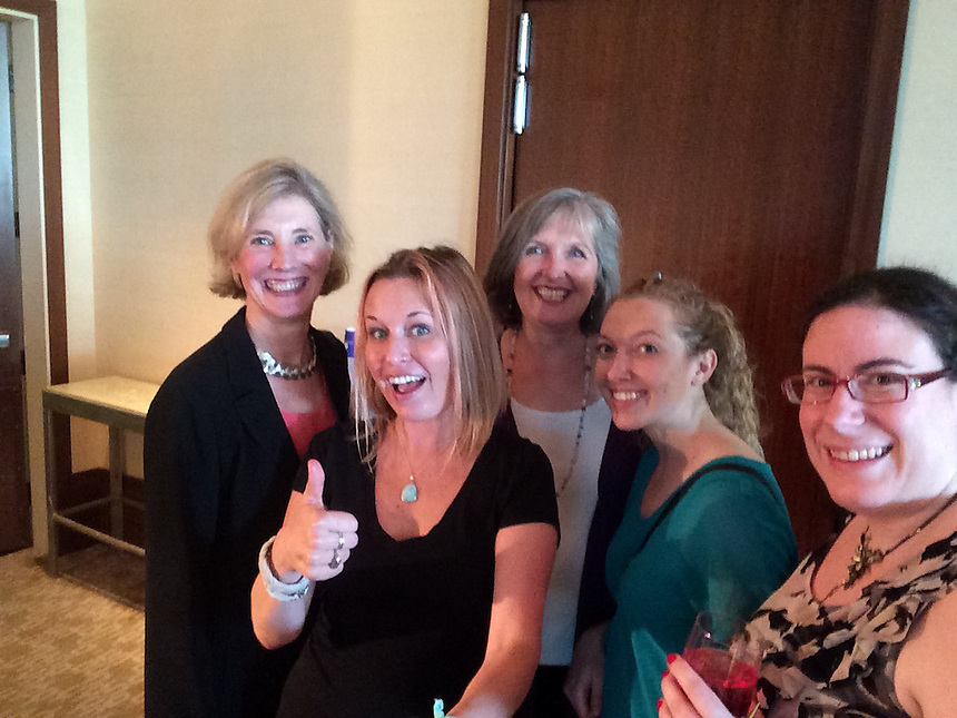 Selfie stick used at the 2015 Staff Appreciation Reception. From left, Christine Hughes and Katie McLaughlin of the Office of General Counsel; and Elise Harrison, Kyle Rundles, and Danya Goodman of Emerson Counseling and Psychological Services.)